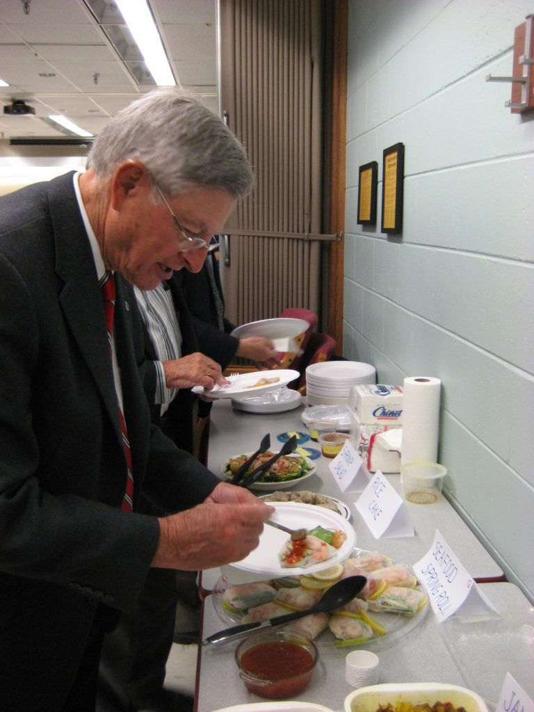 Prof. Mitchell enjoying food prepared by graduate students in a potluck organized during the 6thC.W. Lovell Distinguished Lecture (10/05/06). Photo Contributor: Rodrigo Salgado.